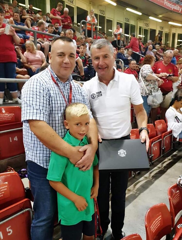 Colby and his dad receive a signed Paul Pogba shirt from United Legend Dennis Irwin