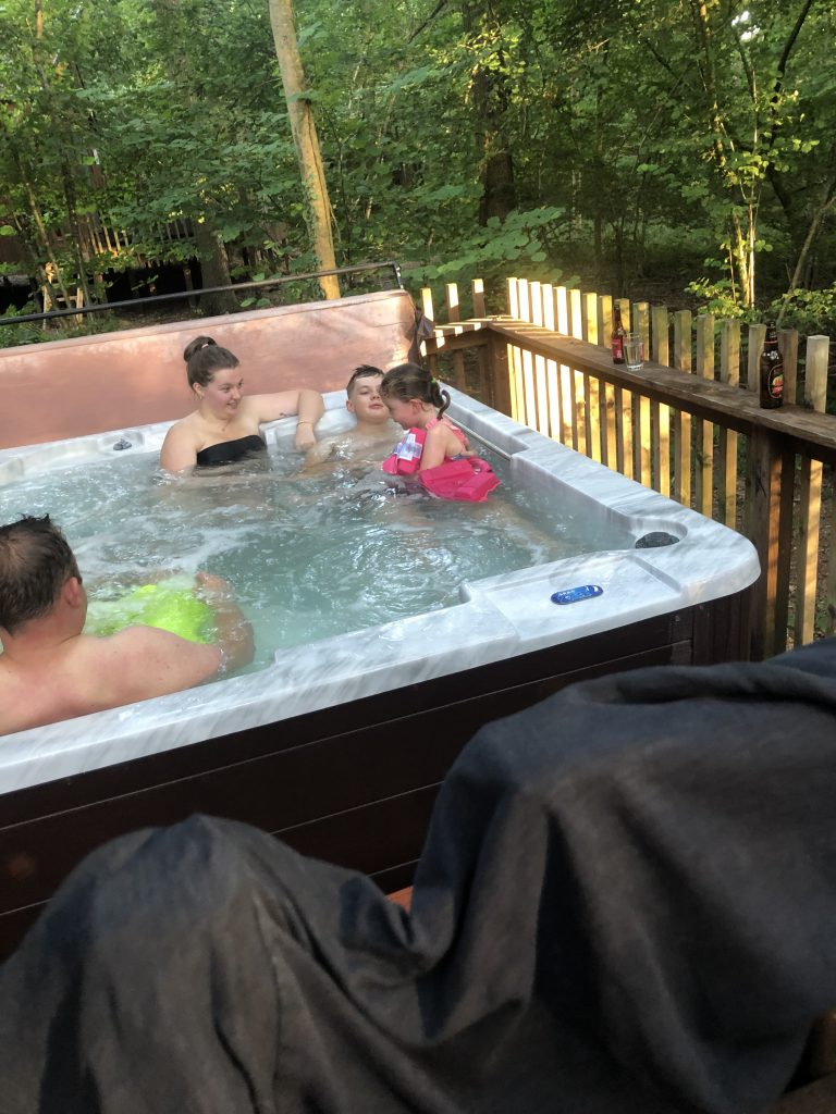 The family enjoying some quality time in the hot tub in their lodge at the Forest of Dean